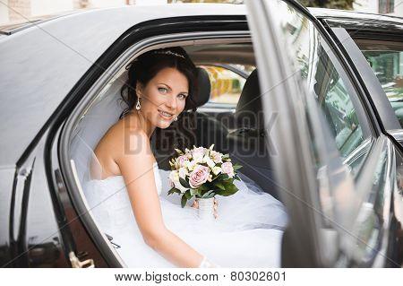 Portrait of a pretty bride in a car