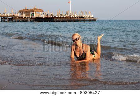 Beautiful girl on sea beach.