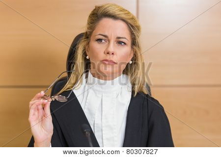 Stern judge looking away in the court room