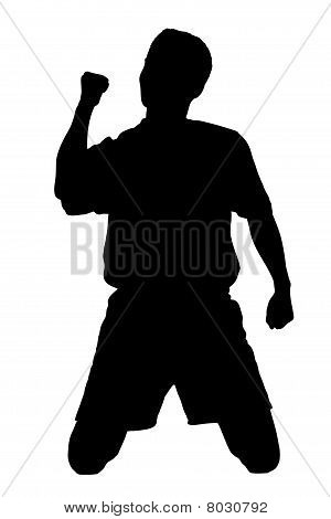 A silhouette of a soccer player