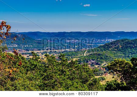 Wide view of a big valley from high on a hill in the famous Texas hill country.