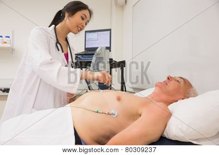 Medical student practicing on older man at the university