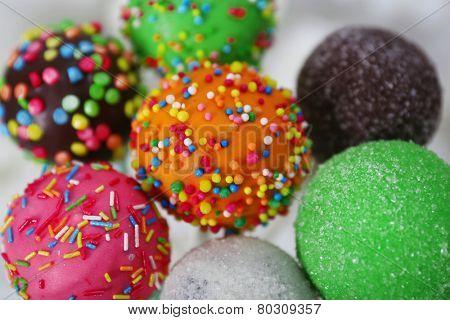 Sweet cake pops in vase close-up