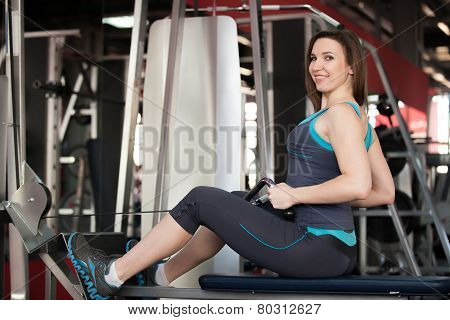 Smiling Girl Doing Back Training On Sport Apparatus
