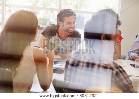 Designers Having Meeting Viewed Through Window