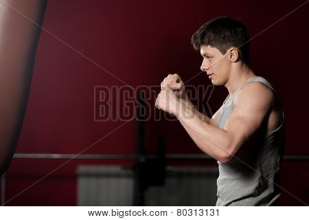 Young Man Warming Up Boxing In Gym