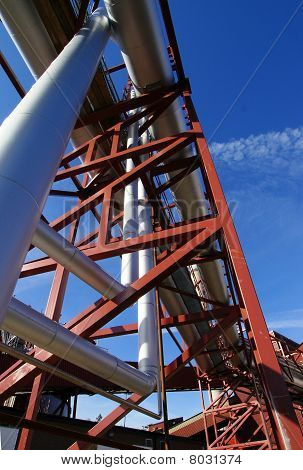 Industrial Zone, Steel Pipelines And Support Structures On Blue Sky