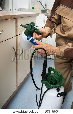 Pest Control Worker Holding Pesticides Sprayer