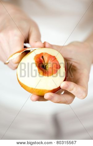 Woman's Hands Pare Red Apple