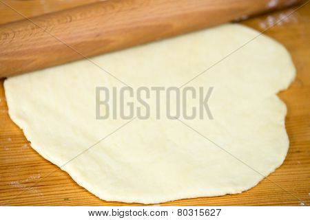 Flattened Dough And Rolling-pin On The Table