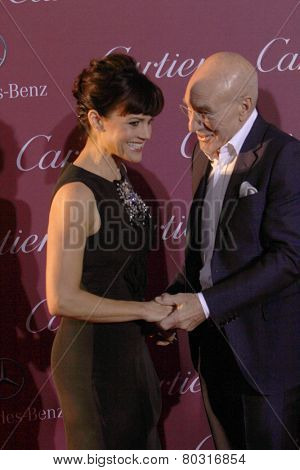 PALM SPRINGS, CA - JAN 3: Carla Gugino and Patrick Stewart arrive at the 2015 Palm Springs Film Festival Awards Gala at the Palm Springs Convention Center on January 3, 2015 in Palm Springs, CA.