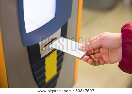 Woman Inserting Parking Ticket Into Machine
