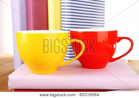 Cups of coffee on wooden surface isolated on white background