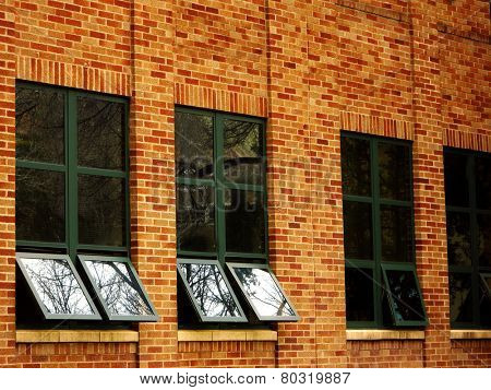Office building details reflecting sky and clouds in windows