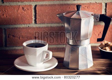 the coffee in mug and coffee maker