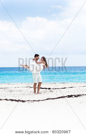 Happy Newlyweds Having Fun On Beach