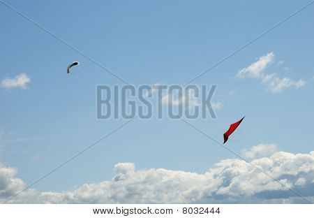 Two kites in the blue sky