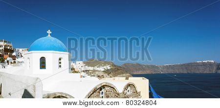 Church With Blue Cupola At Oia Village, Santorini Island.