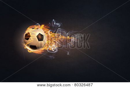 Conceptual image of football ball in fire flames