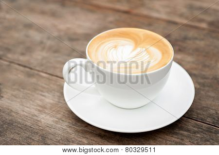 cup of coffee latte art heart