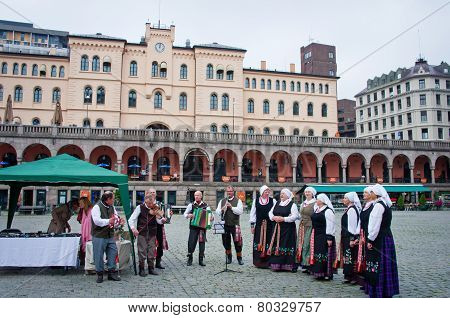 Musicians garbed in period costumes performing   in Oslo, Norway