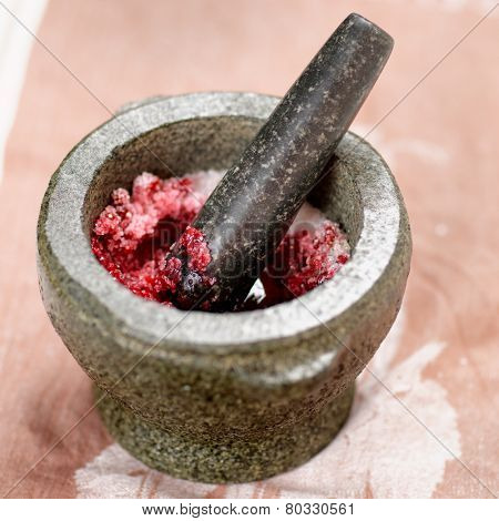 Salt and redberry marinade in granite mortar