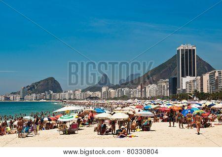 Crowded Copacabana beach on hot summer day