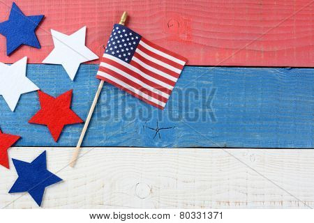 High angle shot of an American Flag and fabric stars on a red, white and blue picnic table. With copy space, perfect for 4th of July and Memorial Day projects.