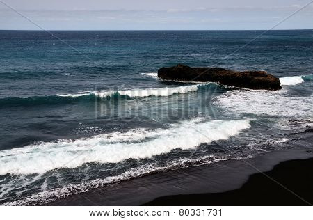 Waves On A Beach With Islet
