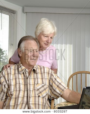 Senior couple on the net