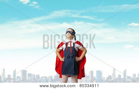 Girl of school age in super hero costume