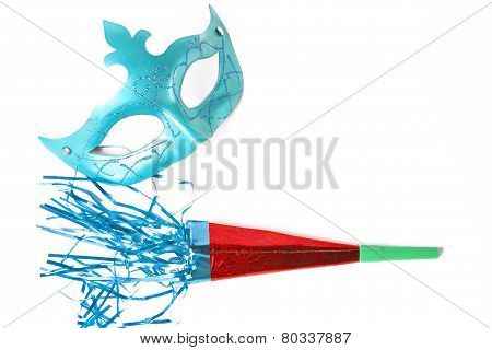 Carnival Mask And Blower On White Background
