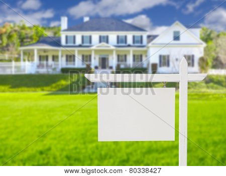 Blank Real Estate Sign in Front of Beautiful New House.