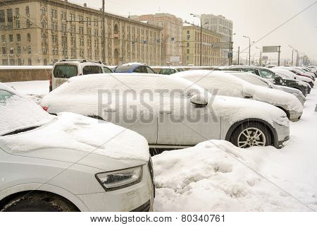 An Image Of Snow Covered Cars In Parking Lot
