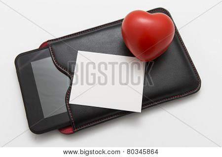 Heart And Tablet On White Background