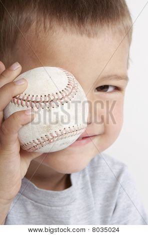 Toddler With Baseball