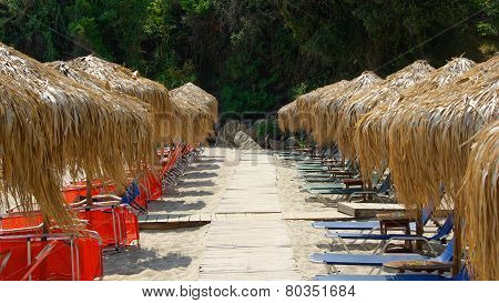 Straw parasols (umbrellas) on Ag Saranta Beach. Pelio, Greece