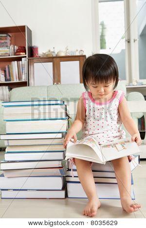 Litlle Girl Reading Lot Of Books