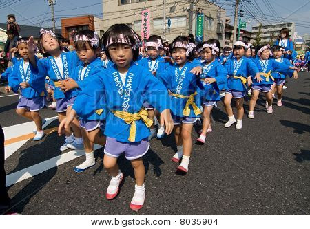 Young Japanese Children Dancing At A Japanese Festival