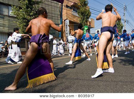 Japanese Festival Dancers wearing sumo belts