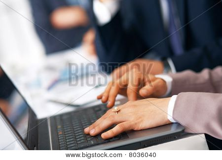 Hands Typing On The Laptop.