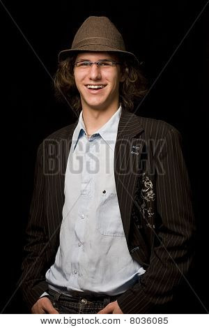 Teen With Hat In A Wrinkle Shirt