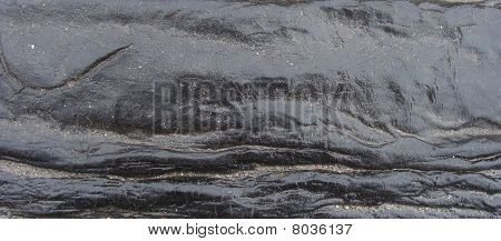 Flow Of Wet Shiny Tar