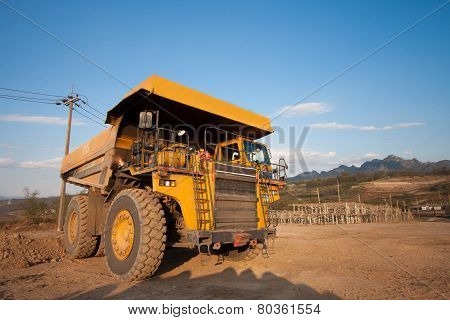 Coal-preparation Plant. Big Yellow Mining Truck At Work Site Coal Transportation