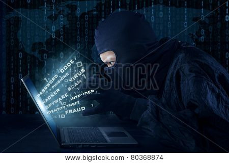 Male Hacker With Mask Stealing Information
