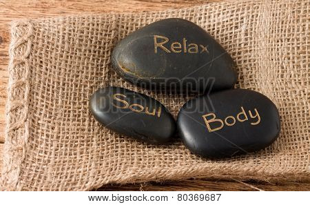 Relax, Soul, Body Three Lava Stones On Jute Cloth