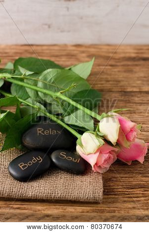 Three Lava Stones And Three Beautifull Pink Roses