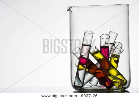 Test tubes with colored liquids in container