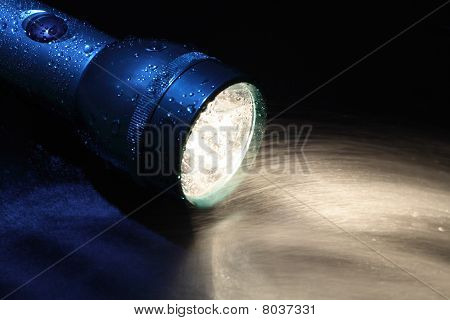 Flashlight And Water