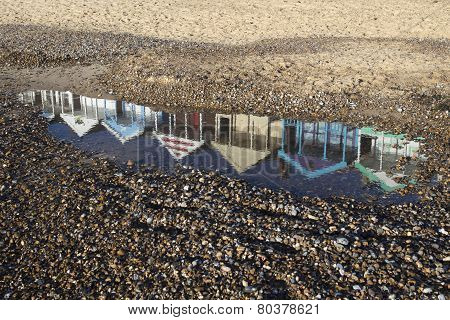 Reflection Of Beach Huts On Southwold Beach, Suffolk, England